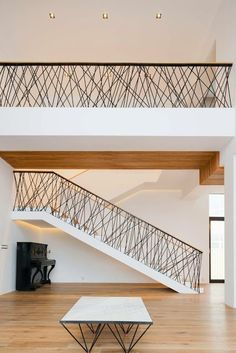 The architecture of this private house is a synthesis of natural materials — s. - The architecture of this private house is a synthesis of natural materials — stone, wood, and sim - Metal Staircase Railing, Interior Stair Railing, Modern Stair Railing, Stair Railing Design, Modern Stairs, Handrail Ideas, Glass Handrail, Pipe Railing, Stair Spindles