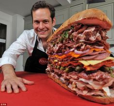 The World's Meatiest Sandwich: Chef Tristan Welch proudly shows off his creation containing over 40 types of meat. O.O