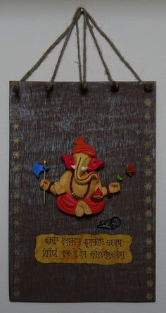 ganesha on polished indian wood: rustic look