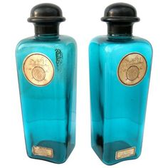 *Vintage Hermes Bottles France Early To Mid 20th Century A beautiful pair of vintage Hermes Cologne bottles. Encased in eye catching aqua/turquoise blue glass with bold bakelite cap