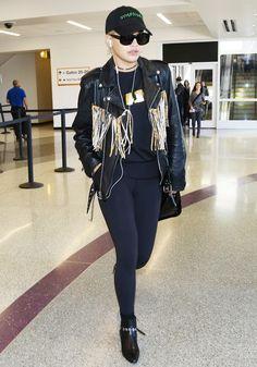 On Rita Ora: Saint Laurent Fringed Leather Jacket ($6490); Lui Black & Gold Tee (GBP 40).