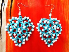 Heart shaped earrings with white pearls made with tatting technique