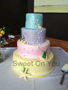 Sweetonyoucakes.ca Under water themed wedding cake with fondant shells, hand painted coral and sugar seaweed