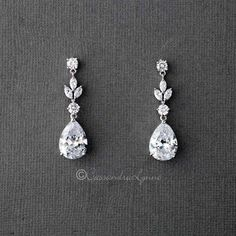 Simply elegant drop earrings with classic styling, a wonderful choice for any wedding ensemble! They are 1.5 inches long, AAA grade CZ, rhodium or rose gold plated, lead and nickel free. #SilverDropEarrings Bridal Earrings, Crystal Earrings, Crystal Jewelry, Bridal Jewelry, Dangle Earrings, Diamond Earrings, Earrings For Wedding, Wedding Jewelry For Bride, Rhinestone Earrings