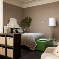 Crisp Contemporary An ornate carved Victorian headboard stands in quirky contrast to mostly sleek contemporary furnishings in this simplistic, modern bedroom.