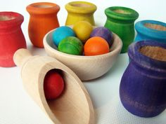 Waldorf - I used to do this with my kids, using balls of various sizes and different sized containers from the kitchen and spoons and ladels - SUPER good for hand-to-eye co-ordination and development!!