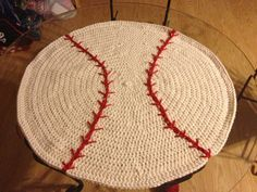 This is a baseball blanket/rug I crocheted for my cousin's baby boy! No pattern other than in my head!