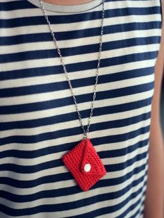 Little crochet envelope necklace {Cute color combination with the navy & white stripes}