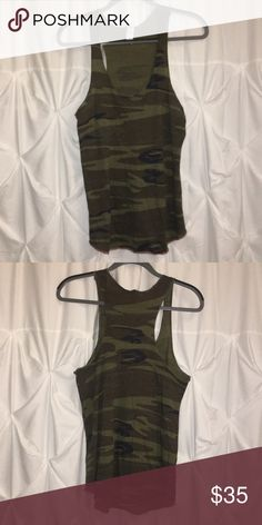 Evereve Camo Tank Very light weight comfortable camo tank top from Evereve. Looks great under a jean jacket and creates a great shape. The neck line is a deep crew neck style. This has never been worn & there is no damage. Tops Tank Tops