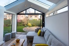 This beautiful Ultraroof house extension features full length glass panels in the roof and stunning bi-fold doors that lead out into the garden. House Extension Design, Extension Designs, Glass Extension, House Design, Extension Ideas, 1930s House Extension, House Extension Plans, Cottage Extension, Rear Extension