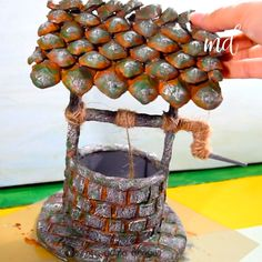 DIY WISHING WELL Whenever we think of decorating gardens, wishing wells seem to always come up. Diy Resin Crafts, Diy Crafts Hacks, Cardboard Crafts, Diy Home Crafts, Diy Arts And Crafts, Craft Stick Crafts, Diy Crafts Videos, Creative Crafts, Fun Crafts