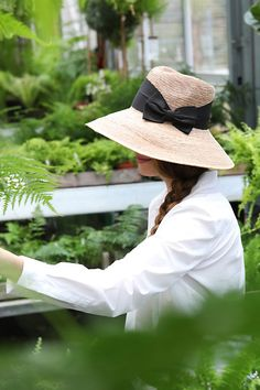An asymmetrical shape and crisp, black bow add stylish appeal to this wide-brimmed sun hat, each one hand-woven using sustainable palm fibers. Wide Brim Sun Hat, Starting A Garden, Sun Hats, Hand Weaving, Home And Garden, Garden Cottage, Palm, Stylish, Anthropologie