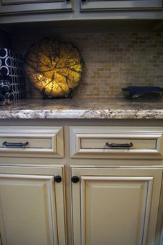 Kitchen cabinets refinished to a custom painted finish with glaze lines.