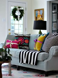 Quick trick for decorating a room for the holidays? Tie cushions with ribbons like a present.