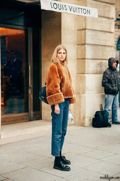 Doctor Martens shoes, straight jeans and fuzzy faux fur high neck sweater