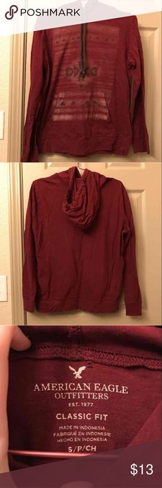 men's hooded long sleeve shirt thin material, hooded long sleeve t shirt. perfect condition, just wrinkled from being folded on the shelf (will come out easily). pretty maroon color and tribal pattern. has pocket like on a hoodie. could also fit a medium (my fiancé is a medium and he wore this) American Eagle Outfitters Shirts Tees - Long Sleeve