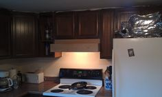 Custom range hood installed.  Just needs priming, painting and some trim. 7/22/2014