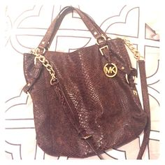 Michael Kors Distressed Python Purse Only carried a couple of times! Perfect condition. Comes with crossbody strap. Michael Kors Bags