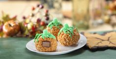 Fun-sized Halloween candy inside a Rice Krispies Treat! Such a neat idea to make with the kids for Halloween. So easy, too!