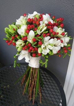 Don't be afraid to mix color and texture for eye-catching appeal with a unique twist. This gorgeous bouquet pops with red Hypericum and sweet-smelling white Freesia! Shop online now for these and other bulk flowers and wedding flowers at GrowersBox.com!