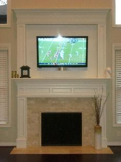 Fireplace tile and TV above