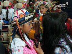 A sponsored child in Quito, Ecuador, has her makeup done before performing in the Youth Talent Show.    Over 100 sponsored children and youth participated in the event. Great job!