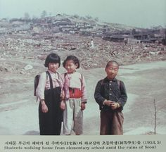 Students walking home from elementary school amid the ruins of Seoul, 1953