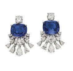 Bulgari: Giardini Italiani High Jewellery earrings in white gold with 1 blue Sri Lanka sapphire (11.12 ct), 1 blue Madagascar sapphire (10.08 ct), round brilliant cut diamonds (2.28 ct) and baguette diamonds (3.61 ct).