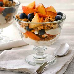 Take a stand against boring breakfasts with our Peach-Blueberry Parfaits. Spruce up a carton of yogurt with juicy peach slices, multigrain cereal, and plenty of blueberries. More blueberry recipes: http://www.bhg.com/recipes/healthy/healthy-blueberry-recipes/ #myplate