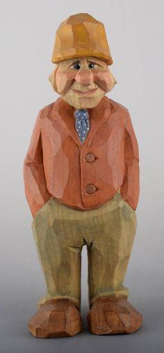 caricature wood carving Nordic Scandinavian immigrant