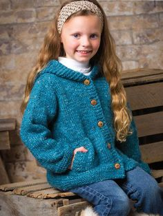 "She will love this hooded cardigan with lots of buttons and roomy pockets, and you'll love that it's quick to make! Knit with 4 (4, 5, 6) hanks of Berroco Inca Tweed yarn at a gauge of 15 sts and 21 rows per 4"" using U.S. size 10/6mm straight an..."