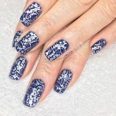 Bright navy nails with silver stamp design.