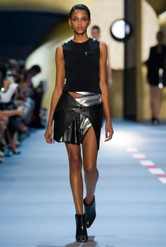 David Koma looked to military uniforms or inspiration with Mugler's spring-summer 2016 show presented during the fifth day of Paris Fashion Week. Opening with nautical influenced looks in white and navy, with buttons and asymmetrical cuts, it was all about body conscious dresses and trousers with skin-baring cutouts at the torso. Koma then moved on …