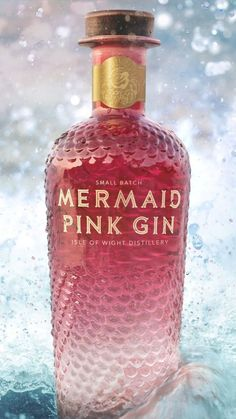Mermaid Pink Gin is made by infusing Isle of Wight Distillery's Mermaid gin with ripe, aromatic island strawberries. The result is a sweet-and-salty gin, with notes of fresh strawberries, salty roc. Alcohol Bottles, Liquor Bottles, Alcoholic Drinks Bottles, Beverages, Cocktails, Cocktail Drinks, Triple Sec, Whisky, Packaging