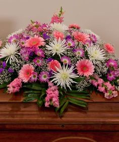Adorn the casket with a loving and elegant casket spray during the funeral service. Nanz & Kraft offers express delivery of casket flowers to Louisville funeral homes backed by our satisfaction guarantee. Casket Flowers, Funeral Flowers, Funeral Floral Arrangements, Flower Arrangements, Funeral Caskets, Funeral Sprays, Casket Sprays, Memorial Flowers, Cemetery Flowers