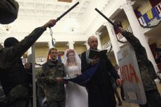 David Mdzinarishvili/Reuters I DO: Ukrainian antigovernment protesters Bogdan, second from left, 21, and Yulia, 25, got married Wednesday in a Kiev municipal building occupied by antigovernment groups.