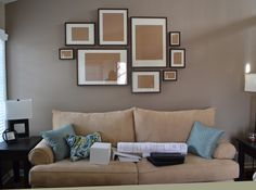 Empty frame collage over sofa.. I like the layout of how the frames were placed on the wall!