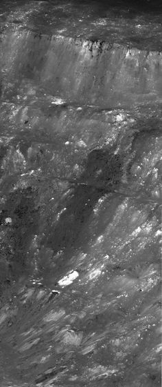 An oblique, high-resolution view of the terraced wall of the Moon's Aristarchus Crater, from rim to floor. Imaged by the Lunar Reconnaissance Orbiter.