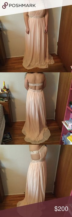 Blush pink open back long formal gown with beading Measurements to come model is 5'4 size L 34D bust. For her dress is too long and bust is large. The dress is stunning blush light pink chiffon with Satan inside and fully lined except for bust. Dress was custom made nothin else like it. Perfect for formal events like prom. Jewels line the top bust and back strap and fully around the upper waist. All beading is perfect and has small train. Only flaws slight marks in bottom not noticeable…