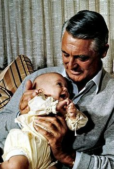 Cary Grant with newborn daughter Jennifer photographed by Philippe Halsman, 1966.