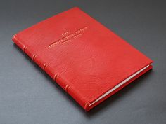 Full leather binding in red goatskin with gold lettering and raised bands on spine