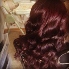 Burgundy I wish my hair looked so SHINY! Great color.