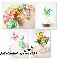Felt pinwheel cupcake toppers.  Darling!