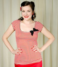 I love stripes! Stand out in the Sea Siren top! This red and cream striped top features the perfect little cap sleeves, nice scoop neck, black dainty lace trim along the collar and sleeves, topped with a decorative black bow. 95% rayon and 5% spandex, VERY stretchy and lightweight. Machine wash cold and lay flat to dry. (Note: Measurements can be stretched about 2 more inches easily.) $32