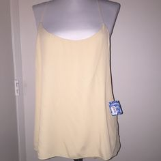 Free people nwt shirt or camisole cream Free people top with open sides and slim back. May be worn over or under Free People Tops Blouses