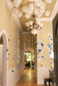 Stylish, pretty and inventive party decorating. A mixture of white and silver balloons would be cool. :)