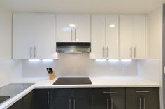 ikea grey cabinets - Google Search  ****keith likes hardware with grey, agree white cabinets are too white, but what do you think of dark and white combo?    Do you mean in terms of cabinets?  I think the contrast is a little too striking.  If you mean dark cabinets/light countertop, I like it