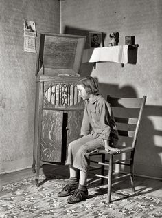 "Listening To Radio, May Crawford County, Illinois. ""Daughter of Farm Security Administration rehabilitation borrower listening to phonograph."" // by John Vachon for the Farm Security Administration"