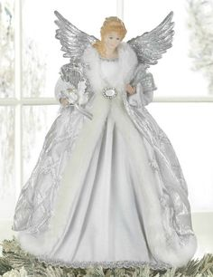 Moving Angel Christmas Tree Toppers | Home / Seasonal / Christmas Decor / White Christmas Angel Tree Topper