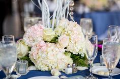 The centerpieces featured blush-colored roses and hydrangeas.  Venue:Lauderdale Yacht Club